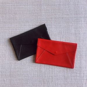 True Red Pebbled Leather Clutch